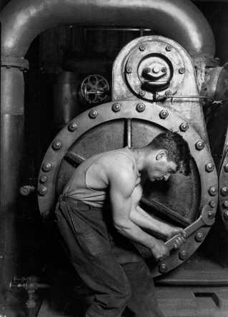 Power house worker adjusting a steam pump