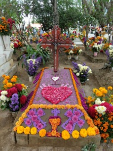 Marigolds and other flowers decorate a grave site at San Antonín.