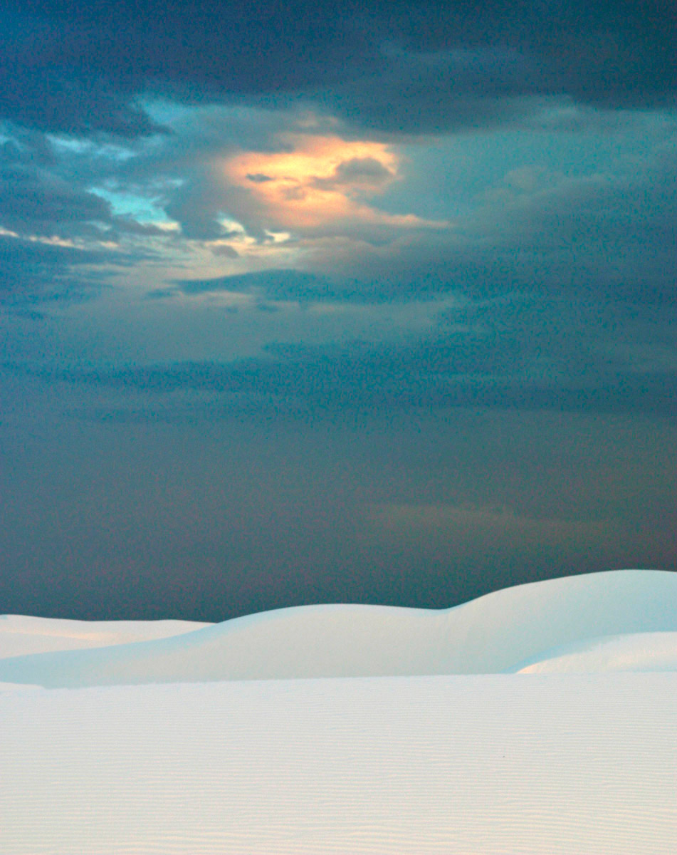 White dunes in foreground with darkened sky