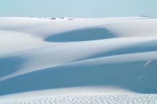 Rolling white dunes to the horizon