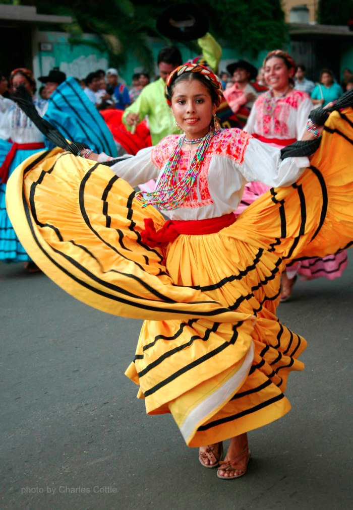 A Dancer from Ejutla de Crespo, Oaxaca - Yellow skirt billowed - She is facing the camera.