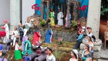Nativity scene with three kings and other guests