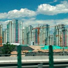 A large high-rise apartment complex construction site.