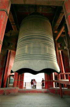 Extremely large bell at old city wall.