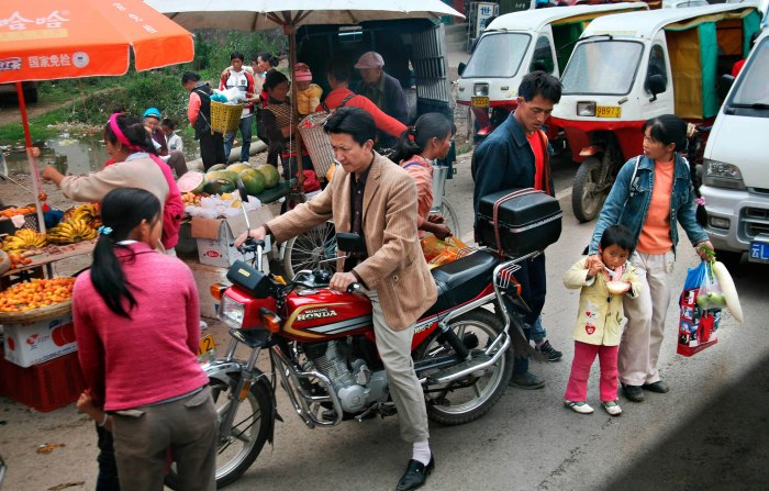 Early Morning Rush - Dali, Yunnan Province, China 2008 Photo: Charles Cottle