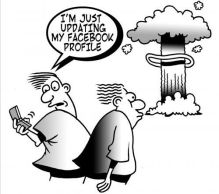 Cartoon: Fellow is updating his facebook account while nuclear warhead explodes.