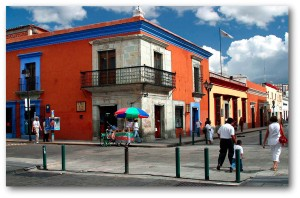 Street scene in the city of Oaxaca. Brightly colored buildings from the 18th century.